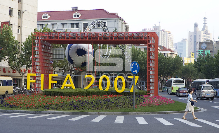 The local organizing committee has set up several large displays throughout the city of Shanghai China to promote the FIFA Women's World Cup. This sign near Hangkou Stadium is lit up each night.