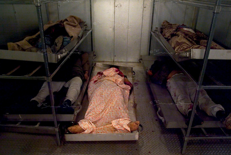 Baghdad, Iraq, March 26, 2003.In the Al Kindi Hospital morgue, the bodies of 5 civilians killed by two US bombs which fell without apparent reason in Cha'ab avenue, a busy street on the edge of Saddam City, one of the poorest neighbourhood in Baghdad.