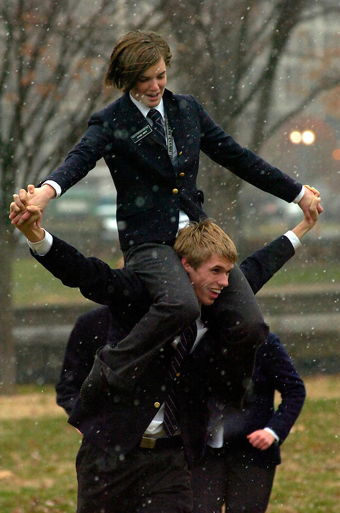 House pages,  Stasie Smith, 16, of California, and Andrew Breest, 16, of Georgia, play in a snowstorm during their lunch break, on the West Front, Monday.