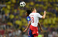 KAZAN - RUSIA, 24-06-2018: Maciej RYBUS (Der) jugador de Polonia disputa el balón con Juan CUADRADO (Izq) jugador de Colombia durante partido de la primera fase, Grupo H, por la Copa Mundial de la FIFA Rusia 2018 jugado en el estadio Kazan Arena en Kazán, Rusia. /  Maciej RYBUS (R) player of Polonia fights the ball with Juan CUADRADO (L) player of Colombia during match of the first phase, Group H, for the FIFA World Cup Russia 2018 played at Kazan Arena stadium in Kazan, Russia. Photo: VizzorImage / Julian Medina / Cont