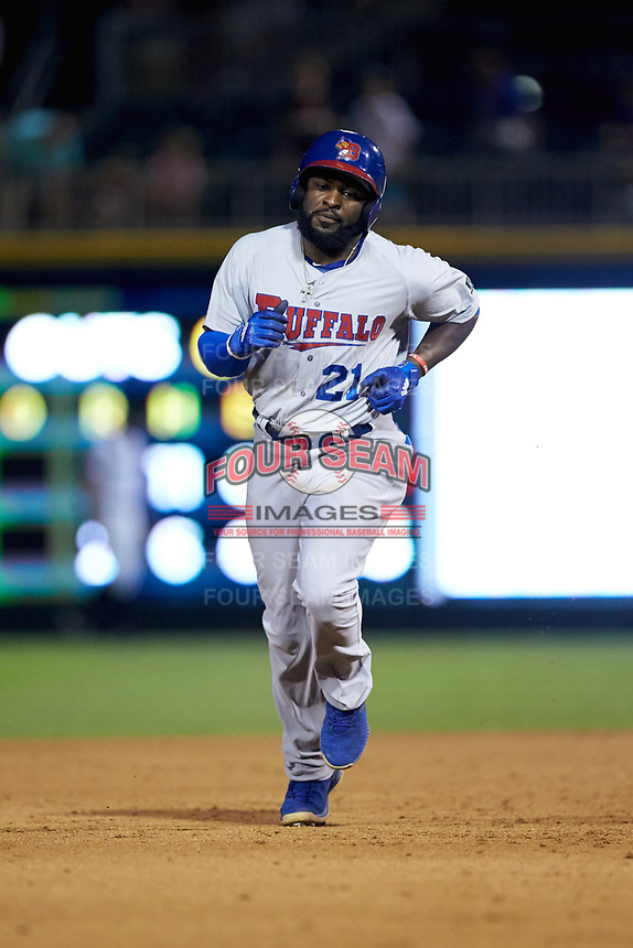 Dwight Smith Jr. (21) of the Buffalo Bison rounds the bases after hitting a home run against the Charlotte Knights at BB&T BallPark on August 14, 2018 in Charlotte, North Carolina. The Bison defeated the Knights 14-5.  (Brian Westerholt/Four Seam Images)