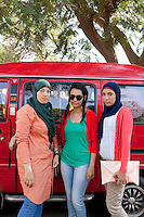 Mohra, Nada and Shrouk stand in front of a car in the campus of Ain Shams University in Cairo, where they are studying psychology, art and law. Cairo, Egypt. October 9th, 2012.