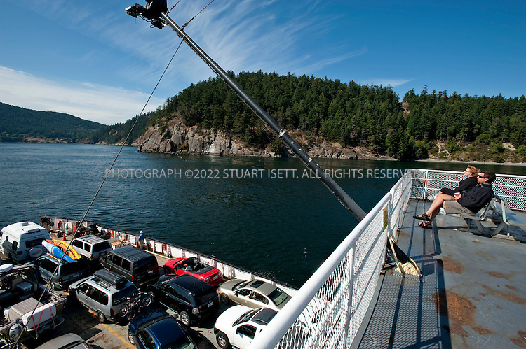 8/24/2009--Gulf Islands, British Columbia, Canada..Passengers on BC Ferry, that runs between vancouver  (Tsawwassen ferry terminal)  and the Southern Gulf Islands, passes through Active Pass between Mayne Island and Galiano Island...©2009 Stuart Isett. All rights reserved.