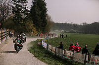 Peloton approaching on the gravel sector; the Plugstreets<br /> <br /> 8th Gent-Wevelgem In Flanders Fields 2019 <br /> Elite Womens Race (1.WWT)<br /> <br /> One day race from Ypres (Ieper) to Wevelgem (137km)<br /> ©JojoHarper for Kramon