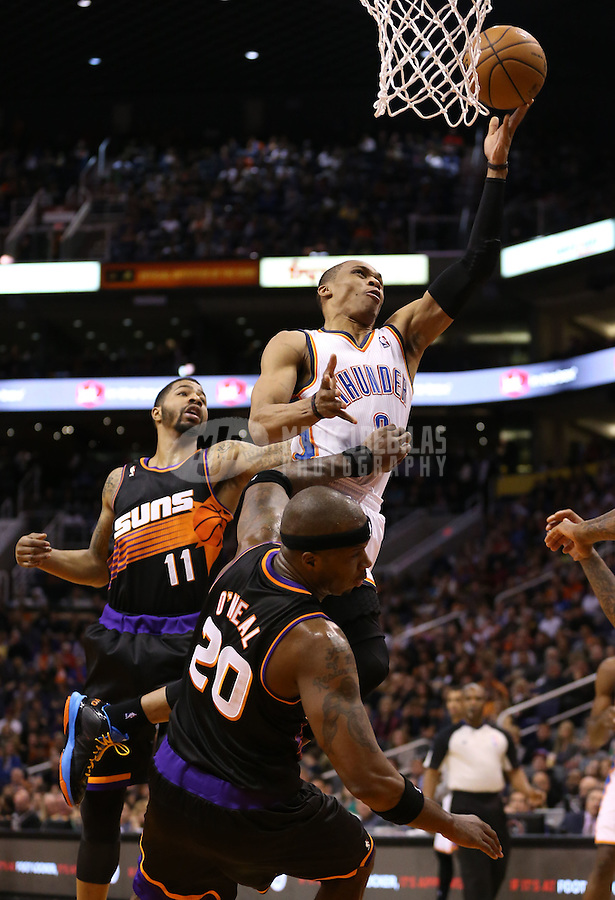 Feb. 10, 2013; Phoenix, AZ, USA: Oklahoma City Thunder point guard Russell Westbrook (0) against the Phoenix Suns at the US Airways Center. Mandatory Credit: Mark J. Rebilas-
