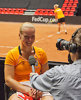 The Netherlands, Den Bosch, 16.04.2014. Fed Cup Netherlands-Japan, practice ,Kiki Bertens (NED) being interviewed by Jan-Willem de Lange<br /> Photo:Tennisimages/Henk Koster