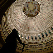 """Nighttime view of the interior of the dome of the United States Capitol from the floor.  The statue of George Washington is silhouetted at the lower left. The fresco in the top of the dome is titled the """"Apotheosis of Washington"""". It was completed by Constantino Brumidi in 1865..Credit: Ron Sachs / CNP"""
