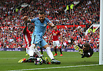 Eric Bailly of Manchester United makes a las ditch tackle on Nicolas Otamendi of Manchester City as David De Gea of Manchester United dives across the near post during the Premier League match at Old Trafford Stadium, Manchester. Picture date: September 10th, 2016. Pic Simon Bellis/Sportimage