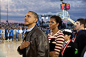 United States President Barack Obama and First Lady Michelle Obama watch the retiring of the colors aboard the USS Carl Vinson, docked at North Island Naval Station in San Diego, California, November 11, 2011. .Mandatory Credit: Pete Souza - White House via CNP