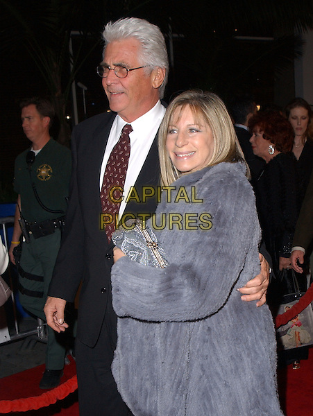 "JAMES BROLIN & BARBARA STREISAND.Universal Pictures' Premiere of ""Meet The Fockers"" held at Universal City Walk in Universal City, California  December 16th, 2004.half length, celebrity couple, black suit, purple fur coat, jacket, clutching purse, bag.www.capitalpictures.com.sales@capitalpictures.com.Supplied By Capital PIctures"