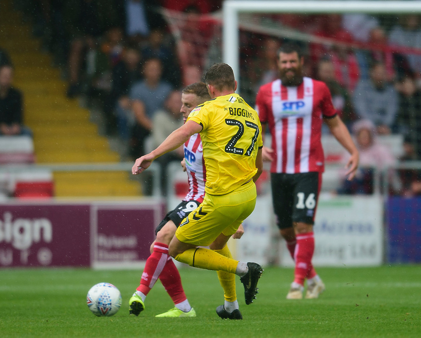 Lincoln City's Joe Morrell battles with Fleetwood Town's Harrison Biggins<br /> <br /> Photographer Andrew Vaughan/CameraSport<br /> <br /> The EFL Sky Bet League One - Lincoln City v Fleetwood Town - Saturday 31st August 2019 - Sincil Bank - Lincoln<br /> <br /> World Copyright © 2019 CameraSport. All rights reserved. 43 Linden Ave. Countesthorpe. Leicester. England. LE8 5PG - Tel: +44 (0) 116 277 4147 - admin@camerasport.com - www.camerasport.com