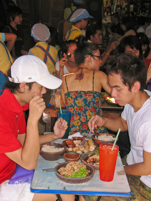 Thai people eating in Chat a Chuk Market. Bangkok, Thailand