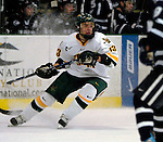 6 January 2007: University of Vermont forward Corey Carlson (13) from Two Harbors, MN, in action against the University of New Hampshire Wildcats at Gutterson Fieldhouse in Burlington, Vermont. The Wildcats defeated Vermont 2-1 to sweep the two-game weekend series in front of a record setting 49th consecutive sellout at the Gut...Mandatory Photo Credit: Ed Wolfstein Photo.<br />