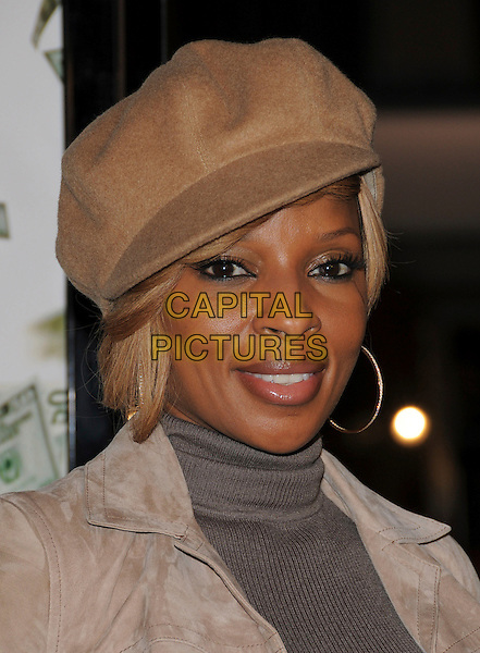 "MARY J. BLIGE.Overature Pictures' L.A. Premiere of ""Mad Money"" held at The Mann Village Theatre in Westwood, California, USA..January 9th, 2008.headshot portrait beige hat hoop earrings polo neck .CAP/DVS.©Debbie VanStory/Capital Pictures"