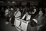 "MAY 9, 2011 - MINEOLA, NY: Young boy, Ramel Smith Jr sitting with sign with ribbon drawn in middle and the message: ""We Mourn the Death of Civil Rights in Nassau County"" at Nassau County Legislature's public hearing on Legislative Redistricting. S At Nassau County Executive and Legislative Building, 1550 Franklin Avenue, Mineola, New York, USA on May 9, 2011"