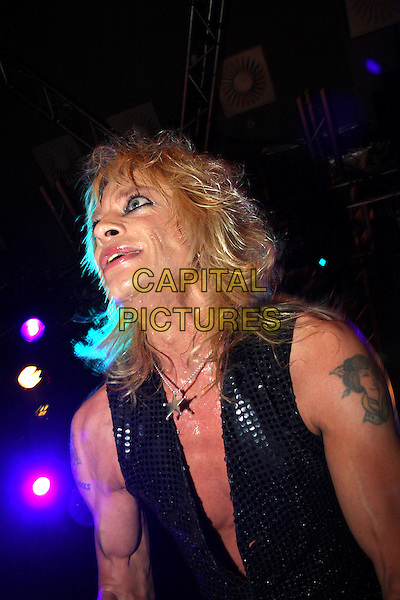 MICHAEL MONROE.Plays live in concert at the Islington Academy, London, England, UK, .April 9th 2010..music gig on stage portrait headshot  black sleeveless vest waistcoat trousers sequined sequin sparkly make-up profile tattoo star silver necklace .CAP/MAR.© Martin Harris/Capital Pictures.