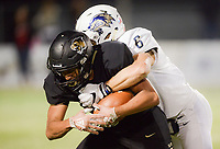 NWA Democrat-Gazette/CHARLIE KAIJO Bentonville High School Donte Jones (15) carries the ball as Bentonville West High School Kobe Anderson (6) tackles during a football game, Friday, November 2, 2018 at Bentonville High School in Bentonville.