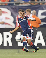 New England Revolution substitute forward Fernando Cardenas (80) passes the ball. In a Major League Soccer (MLS) match, Montreal Impact defeated the New England Revolution, 1-0, at Gillette Stadium on August 12, 2012.