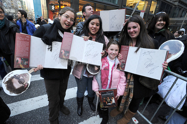 Jonas Brothers fans show their signed copies of ''Burning Up: On Tour with the Jonas Brothers'' at Barnes & Noble on Fifth Ave. in New York City. November 28, 2008 Credit: Dennis Van Tine/MediaPunch