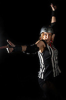 Felonious Feline, number 9LVS, signals lead jammer in this portrait from July 2013.  Felonious is a member of Ref Squadron, the ref crew for Orange County Roller Girls.