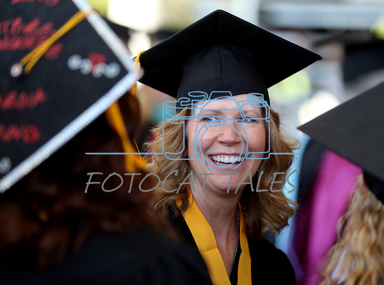 Graduate Sheri Cox talks with friends before the 2013 Western Nevada College Commencement at the Pony Express Pavilion, in Carson City, Nev., on Monday, May 20, 2013. .Photo by Cathleen Allison