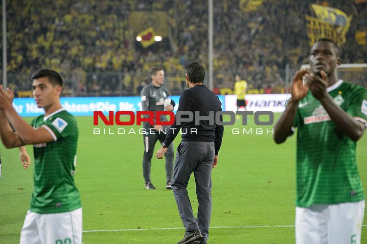23.08.2013, Signal Iduna Park, Dortmund, GER, 1.FBL, Borussia Dortmund vs Werder Bremen, im Bild<br /> Entaeuschung, NIederlage, gestik, Mimik,<br /> &Ouml;zkan / Oezkan Yildirim (Bremen #32)<br /> Assani Lukimya (Bremen #5)<br /> Robin Dutt (Trainer Werder Bremen)<br /> <br /> <br /> Foto &copy; nph / Kokenge