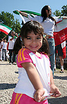 11 June 2006: I young Iranian girl dances as some older fans dance in the background. Mexico played Iran at the Frankenstadion in Nuremberg, Germany in match 7, a Group D first round game, of the 2006 FIFA World Cup.