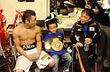 Akira Yaegashi (JPN),  Hideyuki Ohashi, OCTOBER 24, 2011 - Boxing : Akira Yaegashi (L) of Japan is interviewed by the press with Ohashi boxing gym chairman Hideyuki Ohashi (R) as Yaegashi's son Keitaro (C) celebrates with the champion belt after the WBA minimumweight title bout at Korakuen Hall in Tokyo, Japan. (Photo by Mikio Nakai/AFLO)