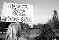 Supporters of President Barack Obama hold up a thank you sign near the White House in Washington, DC on Obama's last day in office, Jan. 19, 2017.