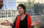 Arab member of the Israeli MK Haneen Zoabi, stands outside a Jerusalem court, where is lader of the radical northern wing of the Islamic Movement in Israel, Sheikh Raed Salah was convicted on October 27, 2015. An Israeli court upheld a conviction of the firebrand Islamic cleric and jailed him for 11 months for inciting violence over Jerusalem's Al-Aqsa mosque in 2007. Photo by Mahfouz Abu Turk