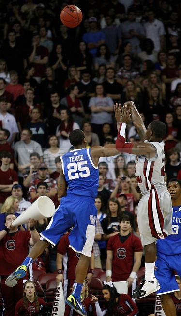 UK point guard MArquis Teague attepmts to block a shot during the first half of the University of Kentucky Men's basketball game against University of South Carolina on 2/4/12 in Columbia, SC. Photo by Quianna Lige | Staff