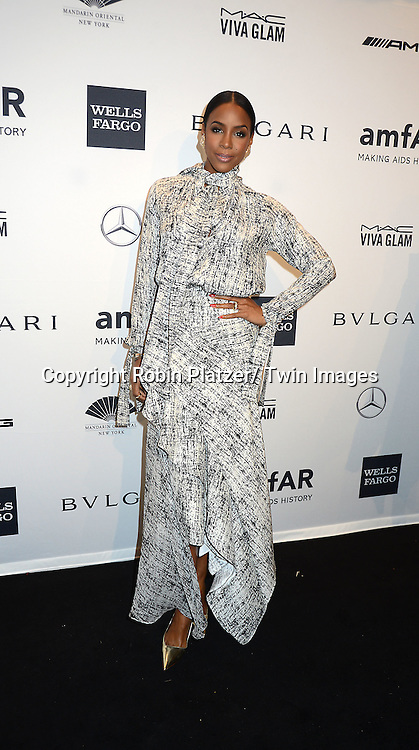 Kelly Rowland attends the amfAR New York Gala on February 5, 2014 at Cipriani Wall Street in New York City.