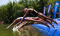 05 JUN 2011 - MADRID, ESP - Competitors dive into the water at the start of the Madrid round of the women's ITU World Championship series (PHOTO (C) NIGEL FARROW)