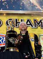Nov 9, 2013; Pomona, CA, USA; NHRA top fuel dragster driver Shawn Langdon celebrates after clinching the 2013 championship following qualifying for the Auto Club Finals at Auto Club Raceway at Pomona. Mandatory Credit: Mark J. Rebilas-