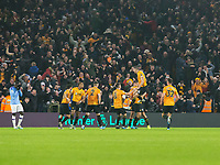 27th December 2019; Molineux Stadium, Wolverhampton, West Midlands, England; English Premier League, Wolverhampton Wanderers versus Manchester City; Raul Jimenez of Wolverhampton Wanderers celebrates with his team after scoring in the 82nd minute to equalise 2-2 - Strictly Editorial Use Only. No use with unauthorized audio, video, data, fixture lists, club/league logos or 'live' services. Online in-match use limited to 120 images, no video emulation. No use in betting, games or single club/league/player publications - Strictly Editorial Use Only. No use with unauthorized audio, video, data, fixture lists, club/league logos or 'live' services. Online in-match use limited to 120 images, no video emulation. No use in betting, games or single club/league/player publications