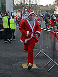 Craig McDonnell was the first Santa across the line in the Drogheda Santa Run to Scotch Hall. Photo:Colin Bell/pressphotos.ie