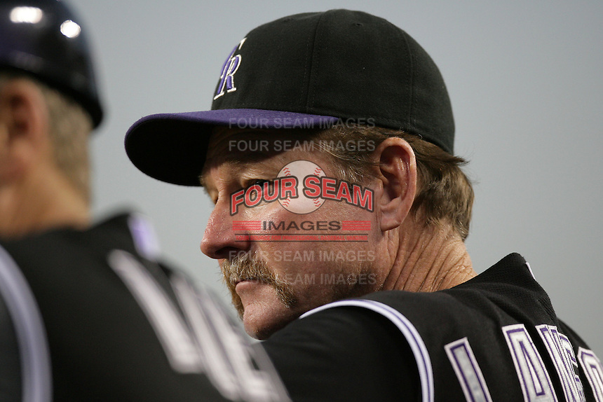 Colorado Rockies coach Carney Lansford #13 watches a game  against the Los Angeles Dodgers at Dodger Stadium on July 26, 2011 in Los Angeles,California. Los Angeles defeated Colorado 3-2.(Larry Goren/Four Seam Images)