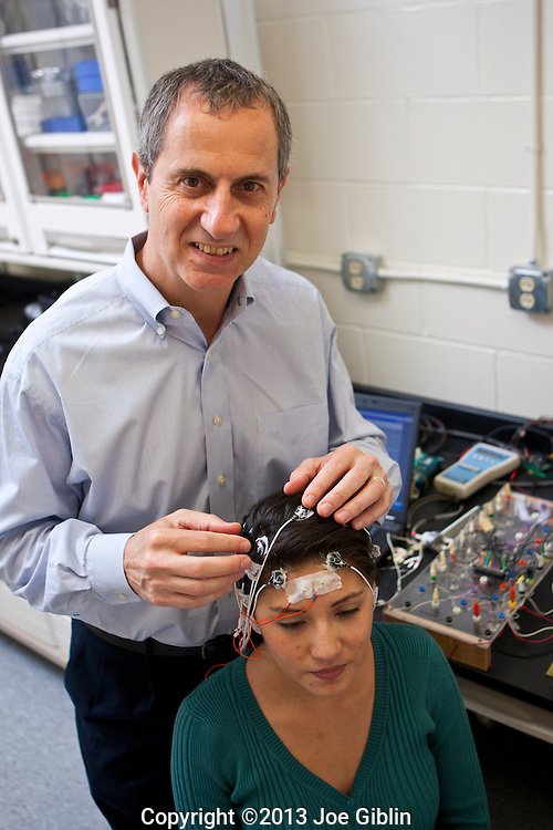 Walt Besio applies brain wave monitoring electrodes to Ivett Acarapi on Tuesday, Oct. 1, 2013 in the animal lab at Peckham Farm on the Kingston Campus in South Kingstown, RI. (Photo/Joe Giblin)---Model Released to URI on file in Marketing & Communications