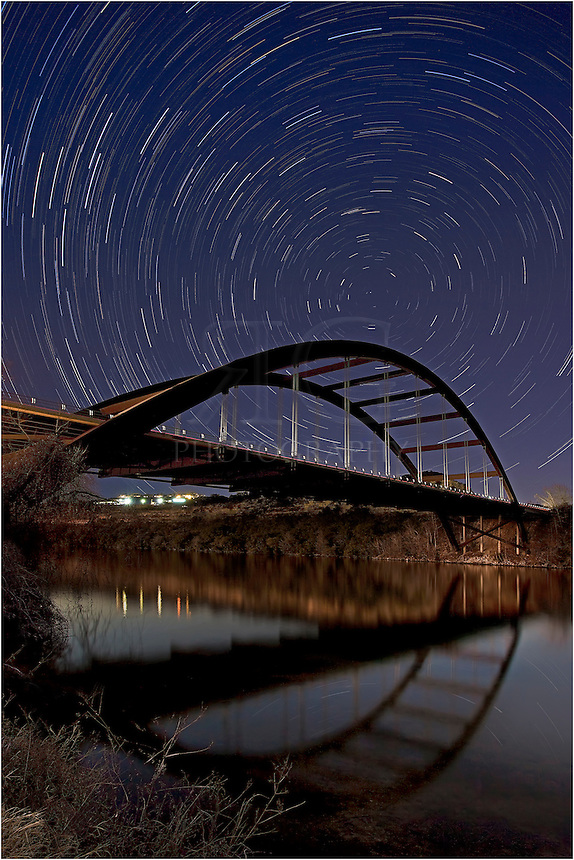 This image of the Pennybacker Bridge (360 Bridge) is comprised of ~ 60 individual 30 second exposures. Blended together, it shows the path of stars when facing north towards Pennybacker in Austin, Texas.
