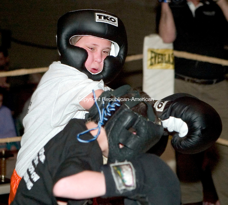 NAUGATUCK, CT- 31 MARCH 07- 033107JT06- <br /> Nate Lindsly punches Kyle Plasky during a round at the Joe Triano Golden Gloves youth boxing tournament at the Naugatuck YMCA on Saturday.<br /> Josalee Thrift Republican-American