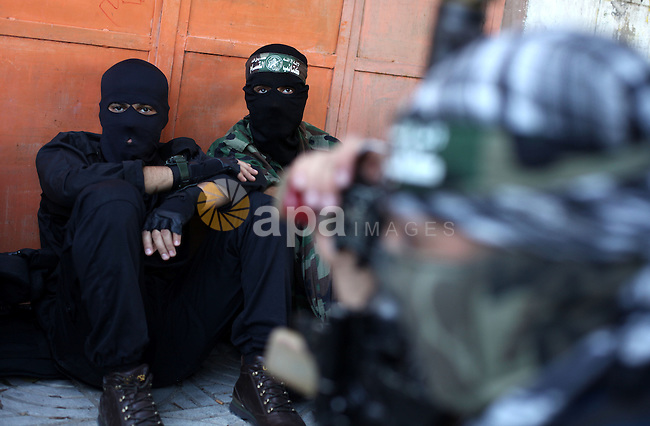 Palestinian militants of the Ezzedine al-Qassam brigade, the armed wing Hamas, attend Friday prayer as they prepare for the arrival of the Islamist movement's exiled politburo chief Khaled Meshaal who is due in the Gaza Strip to celebrate its 25th anniversary on December 7, 2012. Photo by Majdi Fathi