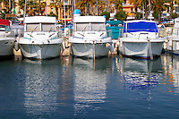 The harbour with boats and buildings along the water in Bandol. White motor yachts Bandol Cote d'Azur Var France