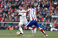 Real Madrid´s spanish midfielder Isco Alarcon and Atletico de Madrid´s Saul