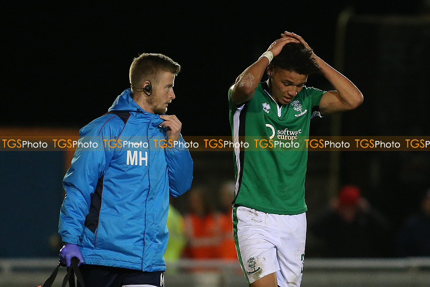 Injury concern for Lee Angol of Lincoln City during Braintree Town vs Lincoln City, Vanarama National League Football at the IronmongeryDirect Stadium on 7th March 2017