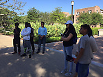 College Success Manager Rick Rodgriguez leading a walking tour of Texas A&M University for 16 students and their families..