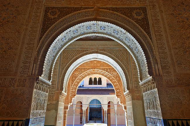 Arabesque Moorish arches in the Palacios Nazaries Alhambra. Granada, Andalusia, Spain.