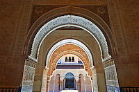 Arabesque Moorish arches in the Palacios Nazaries Alhambra. Granada, Andalusia, Spain.