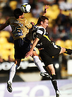 Mark Milligan beats Shane Smeltz to a header during the A-League match between Wellington Phoenix and Newcastle Jets at Westpac Stadium, Wellington, New Zealand on Sunday, 4 January 2009. Photo: Dave Lintott / lintottphoto.co.nz