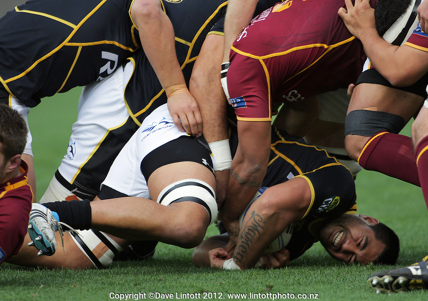 Genisis Mamea takes the ball in during the ITM Cup rugby union match between Wellington Lions and Southland Stags at Westpac Stadium, Wellington, New Zealand on Sunday, 2 September 2012. Photo: Dave Lintott / lintottphoto.co.nz