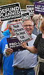 U.S. Congressman Mike Bost walked in a procession to join others at a rally against Planned Parenthood at their new facility, 317 Salem Place in Fairview Heights, IL on October 9, 2019. Students for Life of America and pro-life and anti-abortion advocates in Missouri and Illinois joined together for the protest. Last week, Planned Parenthood announced it had been secretly constructing an updated facility in Illinois, 13 miles from the last existing facility in Missouri.                 <br />                             Photo by Tim Vizer